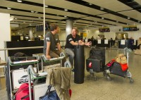 Charley Boorman and Russ Malkin guard the luggage at the airport